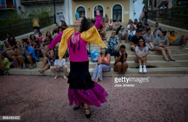 Maria La Marichua Santiago entertains a crowd of Old San Juan residents on October 1 2017 in San Juan Puerto Rico Hurricane Maria caused extensive...