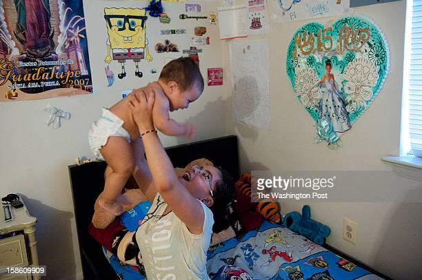 Maria LopezGarcia swings her 8monthold brother into the air in her Lanham MD bedroom LopezGarcia and a dozen other young women participated in the...