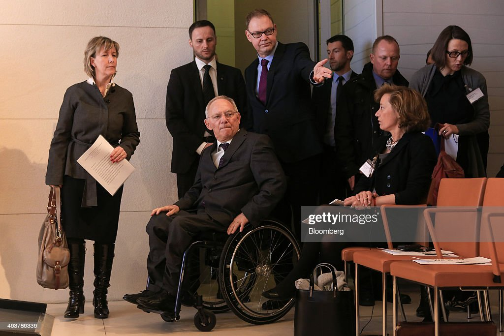 Maria Luis Albuquerque, Portugal's finance minister, left, and Wolfgang Schaeuble, Germany's finance minister, center, arrive for a conference on strengthening Europe's economy at the Bertelsmann Foundation in Berlin, Germany, on Wednesday, Feb. 18, 2015. Greece will submit its request for a six-month loan extension to the euro-area Thursday, a day later than originally planned, according to a government official. Photographer: Krisztian Bocsi/Bloomberg via Getty Images