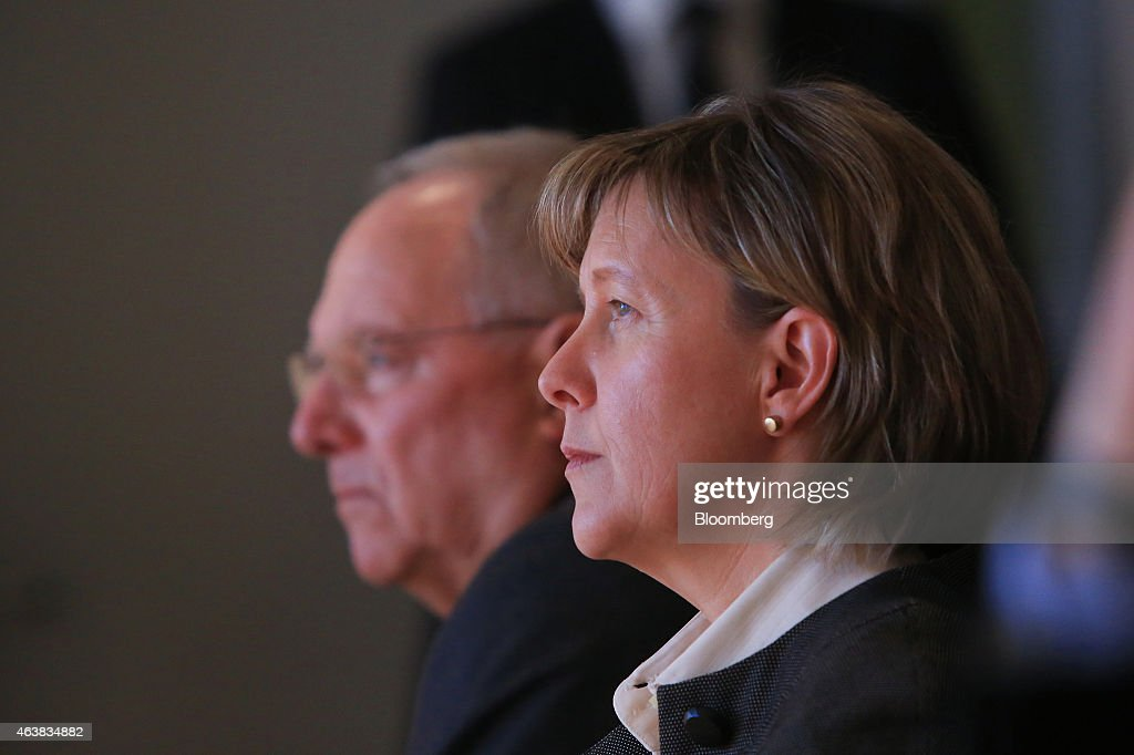 Maria Luis Albuquerque, Portugal's finance minister, right, looks on as she sits beside Wolfgang Schaeuble, Germany's finance minister, during a conference on strengthening Europe's economy at the Bertelsmann Foundation in Berlin, Germany, on Wednesday, Feb. 18, 2015. Greece will submit its request for a six-month loan extension to the euro-area Thursday, a day later than originally planned, according to a government official. Photographer: Krisztian Bocsi/Bloomberg via Getty Images