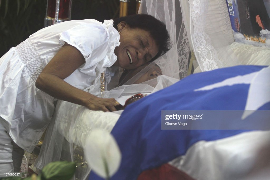 Maria Matias weeps for her late son Hector 'Macho' Camacho at a public memorial service at Department of Sports and Recreation on November 28, 2012 in San Juan, Puerto Rico. Camacho died after being removed from life support following a November 20, 2012 shooting in Bayamon, Puerto Rico.