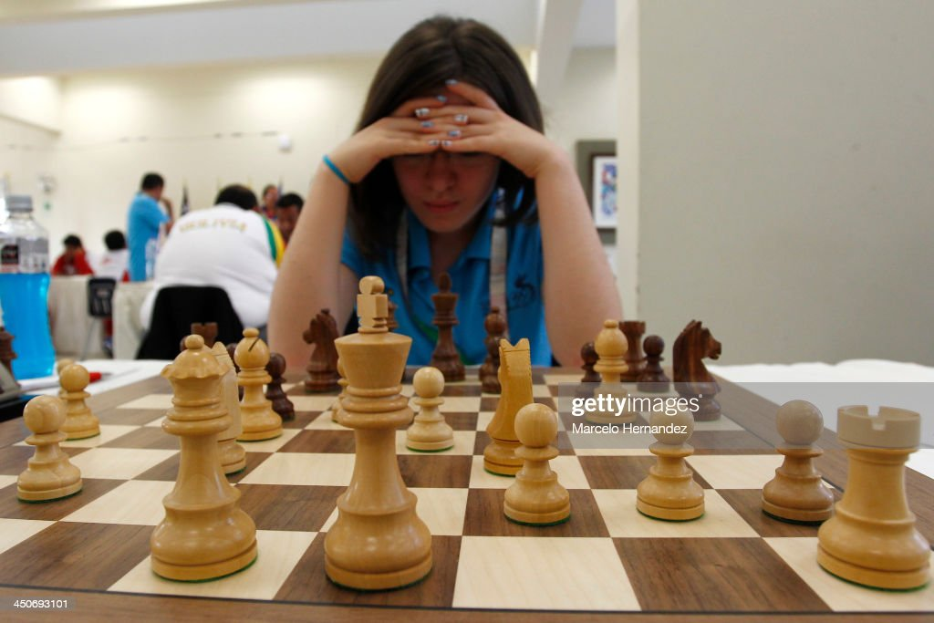 Maria Mencos of Guatemala competes during the opening day of the Chess competition as part of the XVII Bolivarian Games Trujillo 2013 at Colegio San Jose Library on November 19, 2013 in Lima, Peru.