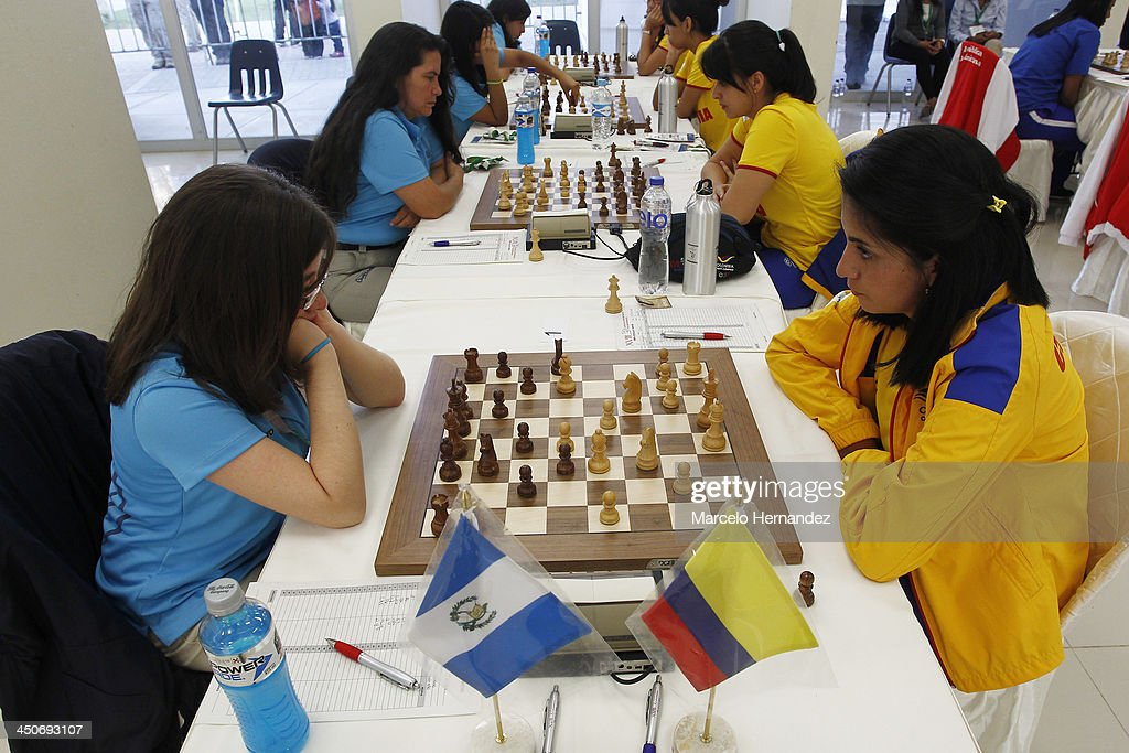 Maria Mencos of Guatemala (L) competes with Paula Rodriguez of Colombia during the opening day of the Chess competition as part of the XVII Bolivarian Games Trujillo 2013 at Colegio San Jose Library on November 19, 2013 in Lima, Peru.