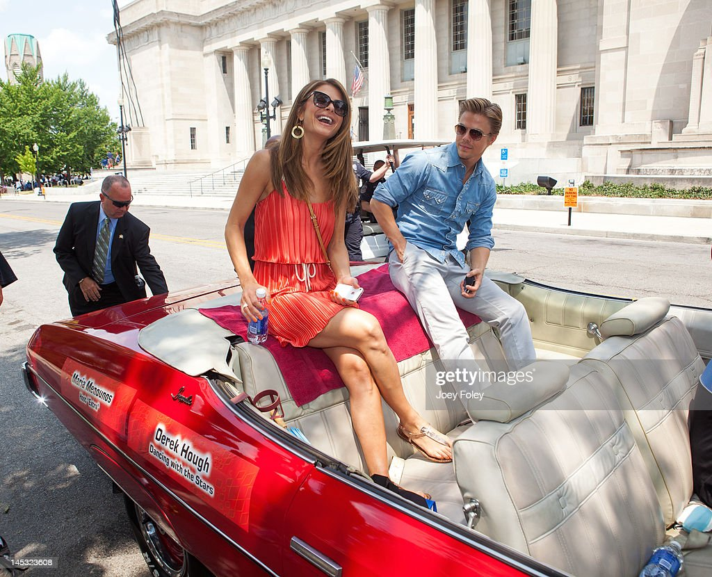 <a gi-track='captionPersonalityLinkClicked' href=/galleries/search?phrase=Maria+Menounos&family=editorial&specificpeople=203337 ng-click='$event.stopPropagation()'>Maria Menounos</a> and <a gi-track='captionPersonalityLinkClicked' href=/galleries/search?phrase=Derek+Hough&family=editorial&specificpeople=4532214 ng-click='$event.stopPropagation()'>Derek Hough</a> attends the IPL 500 Festival Parade on May 26, 2012 in Indianapolis, Indiana.