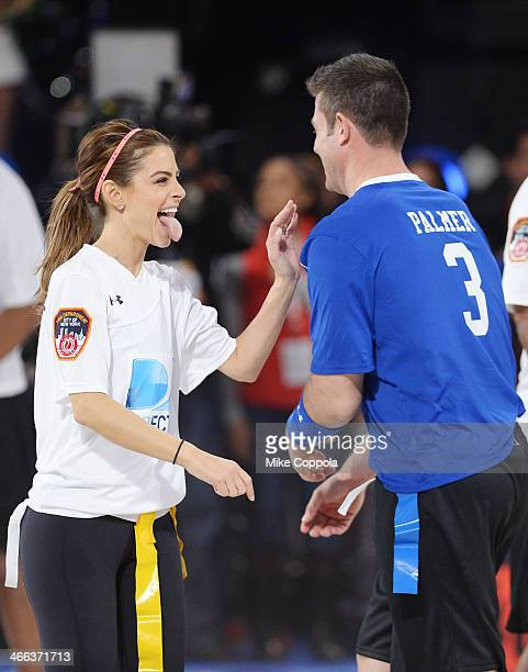 Maria Menounos and Jesse Palmer participate in the DirecTV Beach Bowl at Pier 40 on February 1 2014 in New York City