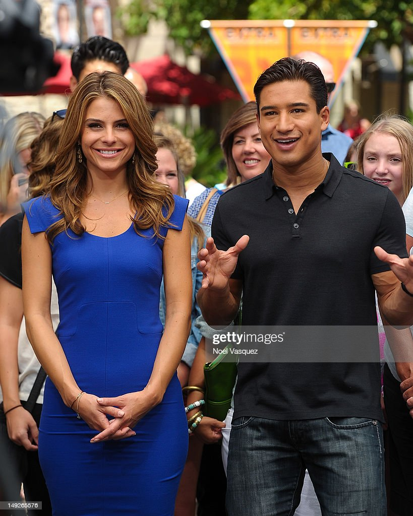 Maria Menounos (L) and Mario Lopez visit 'Extra' at The Grove on July 25, 2012 in Los Angeles, California.