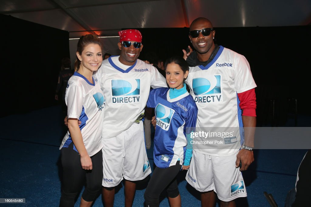 Maria Menounos, Deion Sanders, Rocsi Diaz, and Terrell Owens attend DIRECTV'S Seventh Annual Celebrity Beach Bowl at DTV SuperFan Stadium at Mardi Gras World on February 2, 2013 in New Orleans, Louisiana.