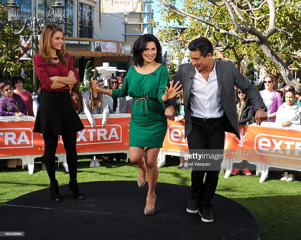 Maria Menounos, Hilaria Baldwin and Mario Lopez dance Ray Lewis's dance Extra at The Grove on January 28, 2013 in Los Angeles, California.
