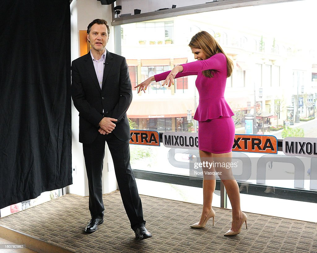 Maria Menounos impersonates a zombie with <a gi-track='captionPersonalityLinkClicked' href=/galleries/search?phrase=David+Morrissey&family=editorial&specificpeople=220896 ng-click='$event.stopPropagation()'>David Morrissey</a> at Extra at The Grove on February 5, 2013 in Los Angeles, California.