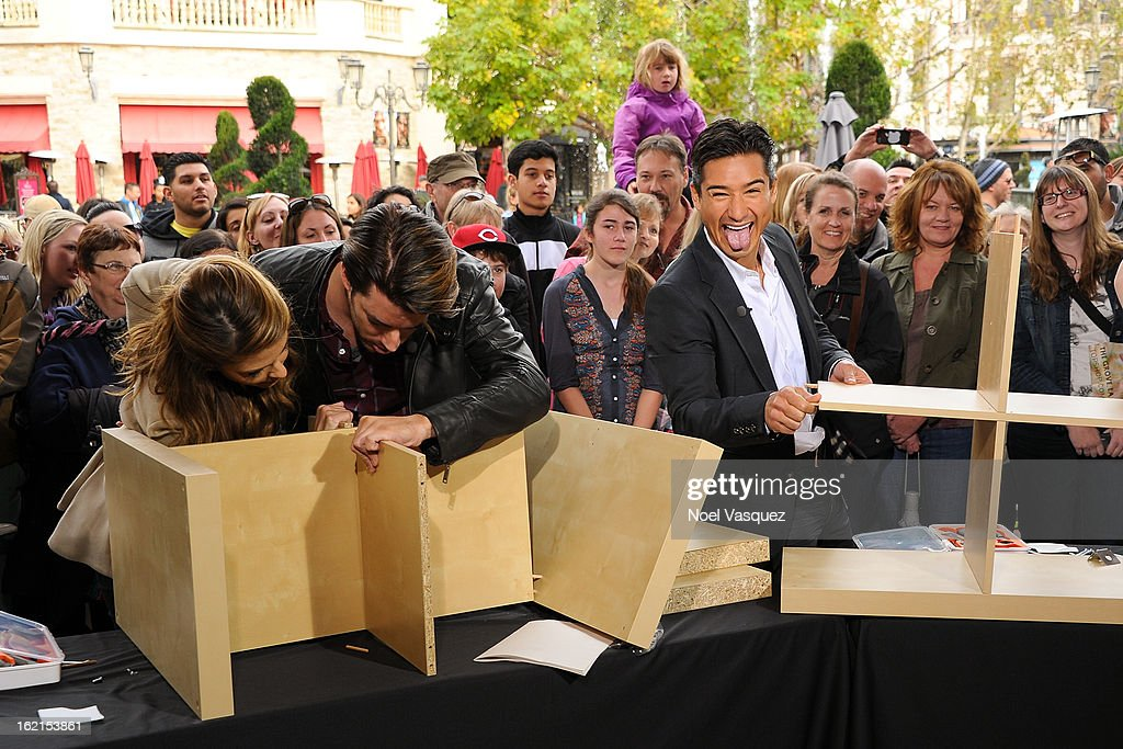 Maria Menounos, Jonathan Scott and Mario Lopez build a bookshelf at Extra at The Grove on February 19, 2013 in Los Angeles, California.