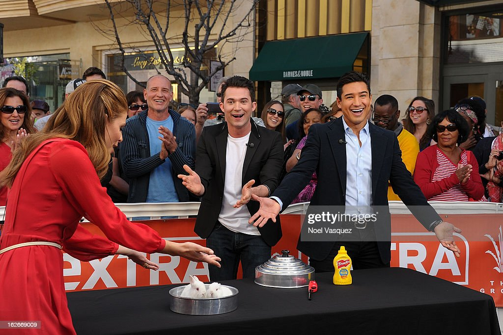 Maria Menounos, Justin Willman and Mario Lopez perform a magic trick at Extra at The Grove on February 25, 2013 in Los Angeles, California.