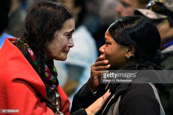 Maria Michael a Lakota elder from San Francisco left embraces US Army veteran Tatiana McLee right during an emotional forgiveness ceremony at the...