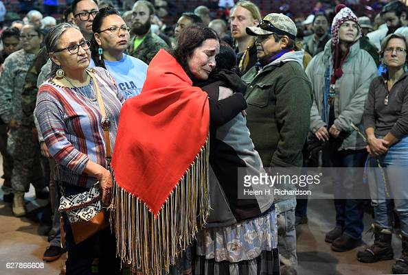 Maria Michael a Lakota elder from San Francisco middle embraces US Army veteran Tatiana McLee right during an emotional forgiveness ceremony at the...
