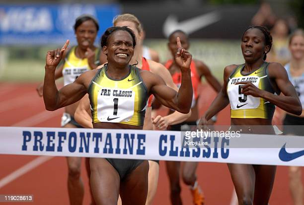 Maria Mutola celebrates after winning the women's 800 meters in the Prefontaine Classic at Hayward Field in Eugene Ore on Sunday June 10 2007
