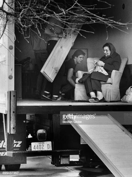 Maria Nunes right crochets inside a moving truck as her son and friend help to move her from her Fenway apartment in Boston March 30 1985