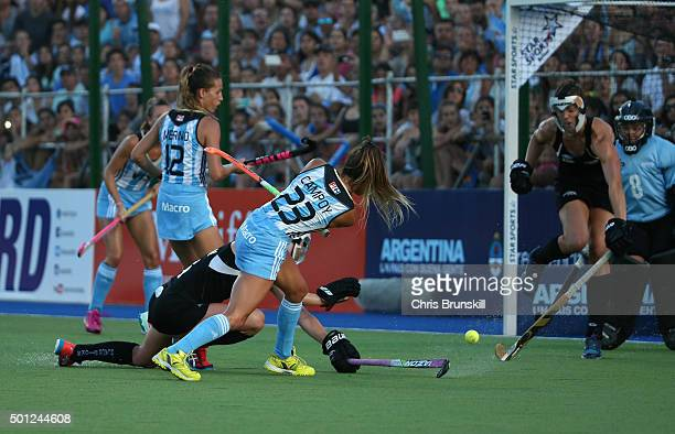 Maria Pilar Compoy of Argentina scores her team's second goal during the final match between Argentina and New Zealand on day 9 of the Hockey World...