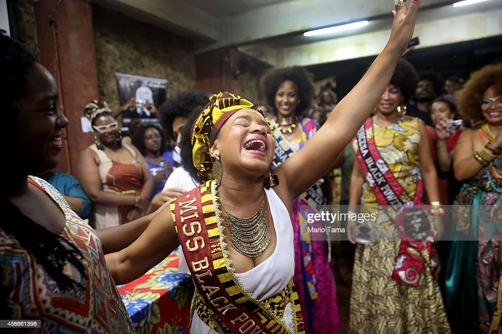 Maria Prisele (C) celebrates after winning the Miss Black Power competition on November 8, 2014 in Rio de Janeiro, Brazil. The non-traditional beauty competition featured black women solely with natural hair as a statement against traditional European standards of beauty and an affirmation of black identity.