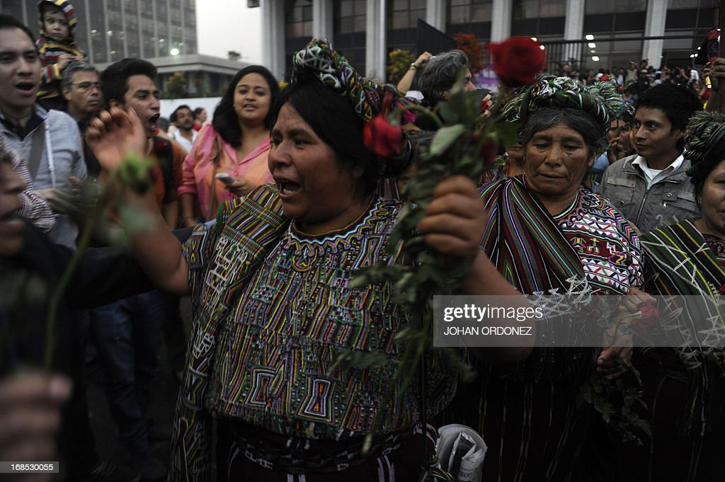 Maria Raymundo, a survivor of Guatemala's civil war, celebrates after listening the sentence given to former Guatemalan de facto President (1982-1983), retired General Jose Efrain Rios Montt, 86, for crimes committed during his regime, in Guatemala City, on May 10, 2013. Rios Montt was found guilty of genocide and war crimes on Friday in a landmark ruling stemming from massacres of indigenous people in his country's long civil war. Rios Montt thus became the first Latin American convicted of trying to exterminate an entire group of people in a brief but particularly gruesome stretch of a war that started in 1960, lasted 36 years and left around 200,000 people dead or missing. AFP PHOTO / Johan ORDONEZ
