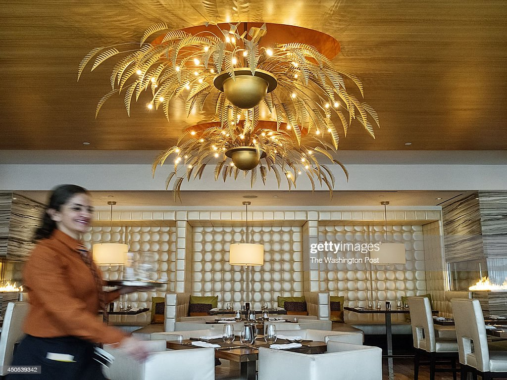 Maria Renteria a restaurant server at Härth walks through the dining room on Saturday April 26 2014 Härth is located inside the Hilton McLean at...