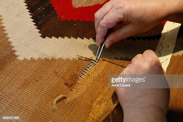 Maria repairs a 1980 Navaho Indian blanket at KO Z Crafts owned by Hratch Kozibeyokian who is renoun as a restorer of rugs from fine oriental rugs to...
