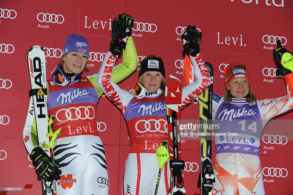 Maria Riesch of Germany, <a gi-track='captionPersonalityLinkClicked' href=/galleries/search?phrase=Marlies+Schild&family=editorial&specificpeople=209135 ng-click='$event.stopPropagation()'>Marlies Schild</a> of Austria and Tanja Poutianen of Finland celebrate placing second, first and third on the podium during the Audi FIS Alpine Ski World Cup Women's Slalom on November 13, 2010 in Levi, Finland.