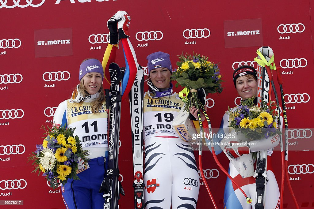 Maria Riesch of Germany takes 1st place, <a gi-track='captionPersonalityLinkClicked' href=/galleries/search?phrase=Ingrid+Jacquemod&family=editorial&specificpeople=228028 ng-click='$event.stopPropagation()'>Ingrid Jacquemod</a> of France takes 2nd place, <a gi-track='captionPersonalityLinkClicked' href=/galleries/search?phrase=Fabienne+Suter&family=editorial&specificpeople=4140509 ng-click='$event.stopPropagation()'>Fabienne Suter</a> of Switzerland takes 3rd place during the Audi FIS Alpine Ski World Cup Women's Downhill on January 30, 2010 in St.Moritz, Switzerland.
