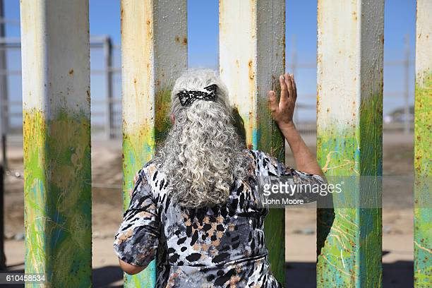 Maria Rodriguez Torres looks towards her departing grandchildren after seeing them for the first time at the USMexico border fence on September 25...