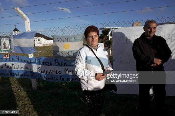 Maria Rosa Belenstro and Jorge Villareal parents of missing submariner Fernando Villareal stand outside Argentina's Navy base in Mar del Plata on the...