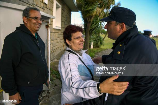 Maria Rosa Belenstro mother of missin submariner Fernando Villareal is greeted by a Navy police officer next to her husband Jorge Villareal at...