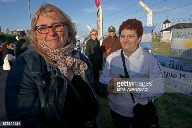 Maria Rosa Belenstro mother of missing submariner Fernando Villareal is comforted by a local woman outside Argentina's Navy base in Mar del Plata on...