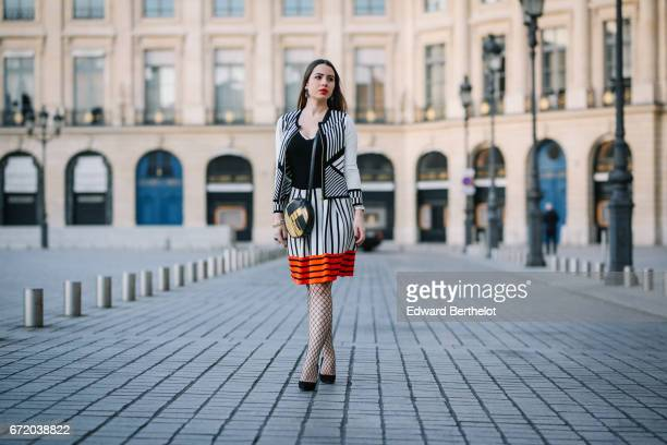 Maria Rosaria Rizzo fashion blogger La Coquette Italienne wears a Knitss striped black white and orange skirt a Knitss black top a Knitss black and...