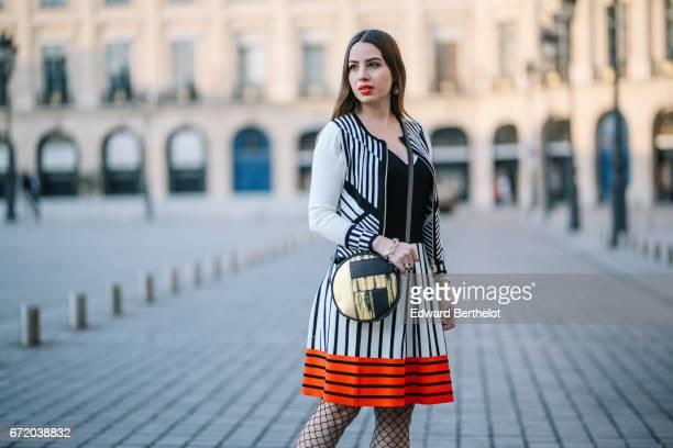Maria Rosaria Rizzo fashion blogger La Coquette Italienne wears a Knitss striped black white and orange skirt a Knitss black top a Knitss black and...