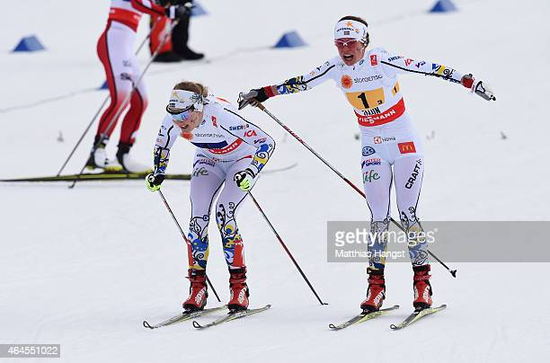 Maria Rydqvist of Sweden hands over to Stina Nilsson of Sweden in the Women's 4 x 5km CrossCountry Relay during the FIS Nordic World Ski...