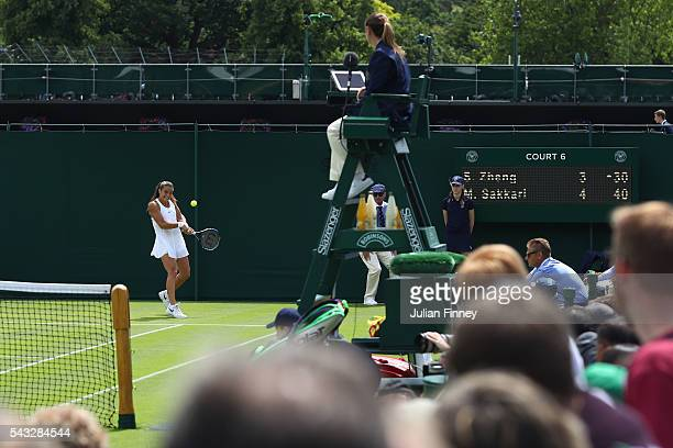 Maria Sakkari of Greece plays a back hand shot during the Ladies Singles first round match against Saisai Zheng of China on day one of the Wimbledon...