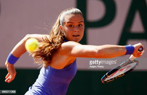 Maria Sakkari of Greece plays a backhand during the ladies singles first round match against Carla Suarez Navarro of Spain on day three of the 2017...