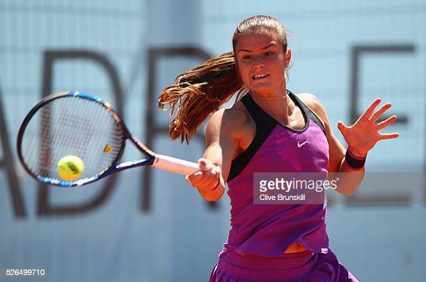 Maria Sakkari of Greece plays a forehand against Patricia Maria Tig of Romania in their second round qualifying match during day one of the Mutua...