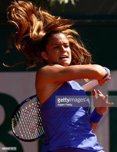 Maria Sakkari of Greece plays a forehand during the ladies singles first round match against Carla Suarez Navarro of Spain on day three of the 2017...