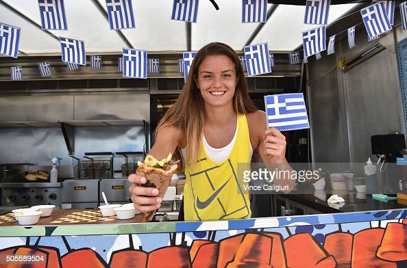 Maria Sakkari of Greece poses after making a greek gyros at Gazi pop up restaurant at Birrarung Marr during day two of the 2016 Australian Open at...