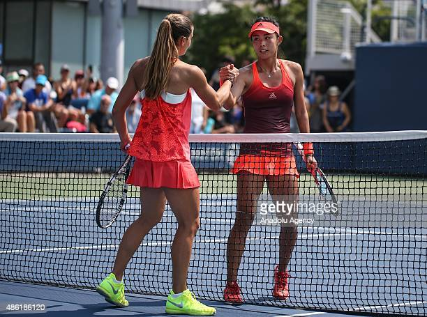 Maria Sakkari of Greece Qiang Wang of China greets each other during their women's singles match on the second day of the 2015 US Open Tennis...