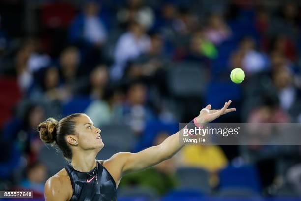 Maria Sakkari of Greece serves against Caroline Garcia of France on Day 6 of 2017 Dongfeng Motor Wuhan Open at Optics Valley International Tennis...