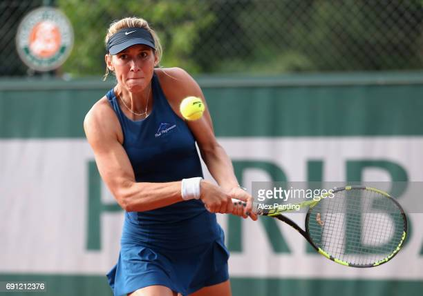Maria Sanchez of The Unites States partner of Naomi Brady of Great Britain plays a backhand during the ladies doubles first round match against...
