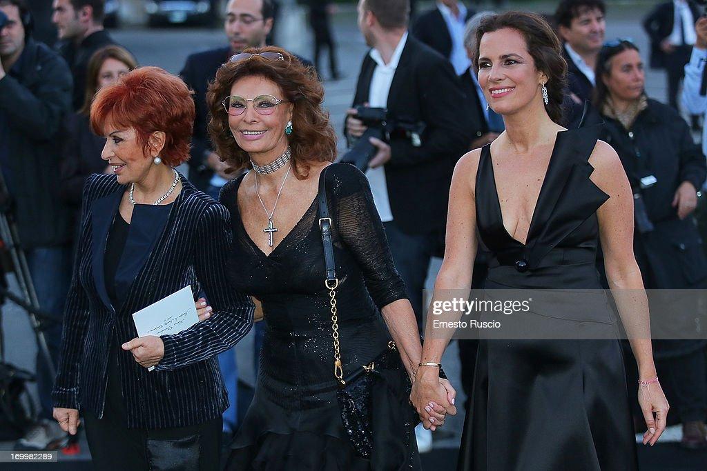 <a gi-track='captionPersonalityLinkClicked' href=/galleries/search?phrase=Maria+Scicolone&family=editorial&specificpeople=969296 ng-click='$event.stopPropagation()'>Maria Scicolone</a>, Sophia Loren and <a gi-track='captionPersonalityLinkClicked' href=/galleries/search?phrase=Roberta+Armani&family=editorial&specificpeople=2082135 ng-click='$event.stopPropagation()'>Roberta Armani</a> attend 'One Night Only' hosted by Giorgio Armani at Museo Della Civilta Del Lavoro in Roma on June 5, 2013 in Rome, Italy.