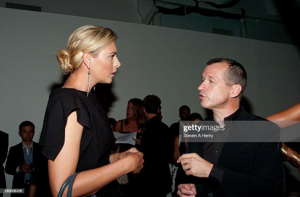 Maria Sharapova and Dr Juergen Gessler CEO Porsche Design Group attend the Porsche Design show during Spring 2014 MercedesBenz Fashion Week at Center...