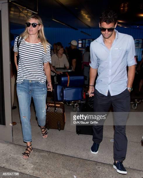 Maria Sharapova and Grigor Dimitrov seen at LAX on July 11 2014 in Los Angeles California