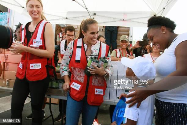 Maria Sharapova and Monica Puig deliver aid to Hurricane Maria victims at Centro Tau on October 23 2017 Loiza Puerto Rico