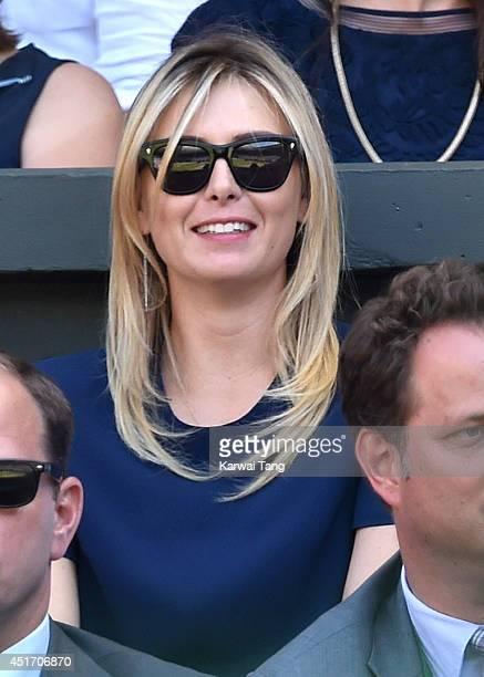 Maria Sharapova attends the semifinal match between Novak Djokovic and Grigor Dimitrov on centre court at The Wimbledon Championships at Wimbledon on...