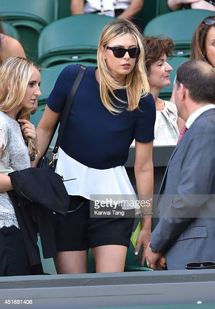 Maria Sharapova attends the semifinal match between Noval Djokovic and Grigor Dimitrov on centre court at The Wimbledon Championships at Wimbledon on...
