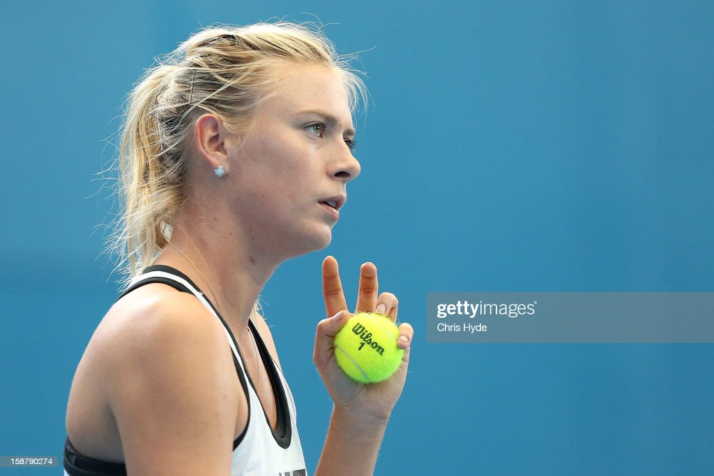 Maria Sharapova looks on during a practice session at Pat Rafter Arena on December 29, 2012 in Brisbane, Australia.