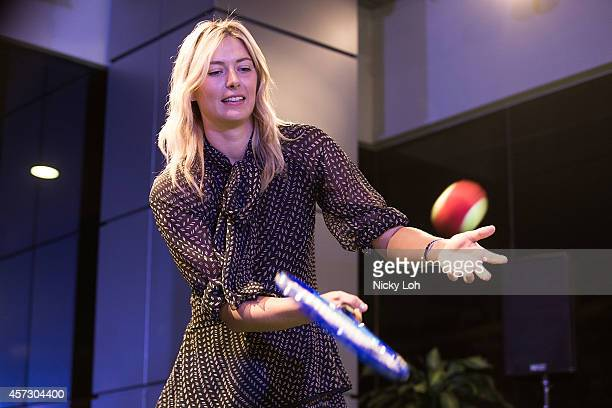 Maria Sharapova Maria Sharapova wearing a Chloe dress Kurt Geiger shoes and a watch by TAG Heuer plays minitennis as she attends a charity event with...