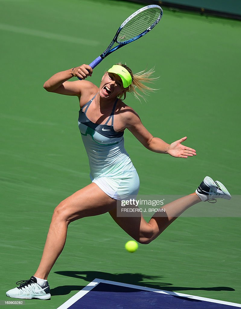 Maria Sharapova of Russi hits a forehand return against Caroline Wozniacki of Denmark on March 17, 2013 in Indian Wells, California, in the women's tennis final at the BNP Paribas Open. AFP PHOTO/Frederic J. BROWN
